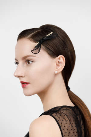female portrait, hair parted and pinned up with golden geometric hairpins in a minimalist design collected in ponytail, studio catalog shooting on white background, Korean and Chinese jewelry concept