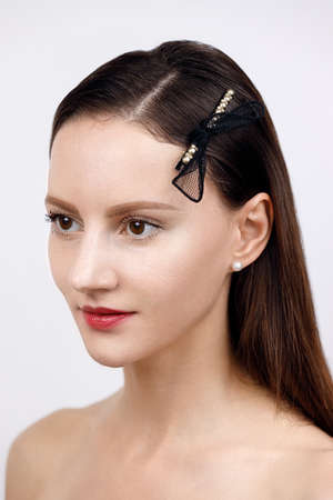 female portrait, loose hair with a high pile parted and pinned up with golden geometric hairpins in a minimalist design, studio catalog shooting on white background, Korean and Chinese jewelry concept