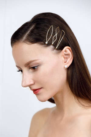 female portrait, loose hair with high pile parted, pinned up with golden geometric hairpins in minimalist design, studio catalog shooting on white background, Korean and Chinese jewelry concept