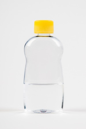 Body massage baby oil in a clear bottle on a white background