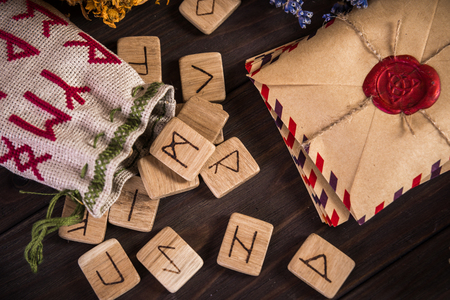 old envelope: Bunch Of Dried Herb That Usually Is Used In Different Ritual, Magic And Cleaning, runes, old envelope with wax stamp and candle