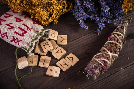 wax stamp: Bunch Of Dried Herb That Usually Is Used In Different Ritual, Magic And Cleaning, runes, old envelope with wax stamp and candle