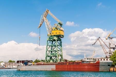 cargo terminal cranes ship in industrial port
