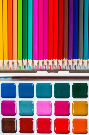 Color pencils and watercolor on white background, back to school Stock Photo