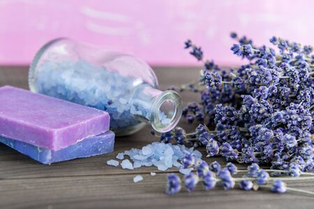 bath essence: Aromatherapy oil and lavender spa, Wellness with lavender, salt on a wooden background Stock Photo