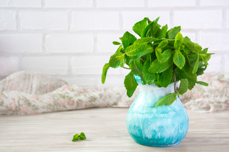 sheaf of fresh mint leaf on rustic background. Copy space. Stock Photo