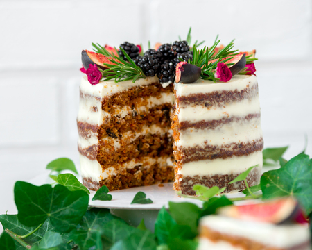 delicious and very pretty carrot walnut cake with figs and rosemary.