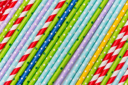 colorful cocktail tubes lie closeup. Top view image