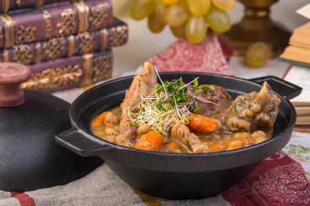 Traditional thick soup made from sauerkraut with pork, smoked pork ribs, sausages, capers and lemon