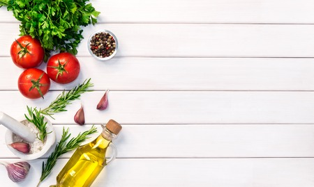 Fresh organic ingridients of italian recipes. Healthy food concept on white wooden table background. Top view, copy space. Stock Photo