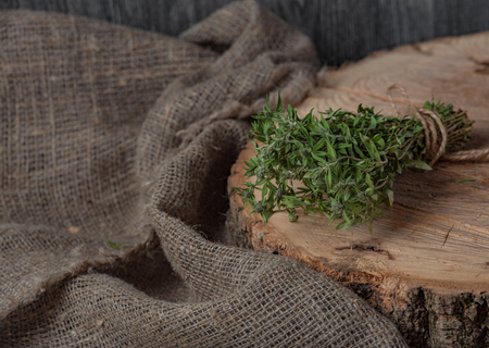 Food background of herb thyme on black kitchen table from above