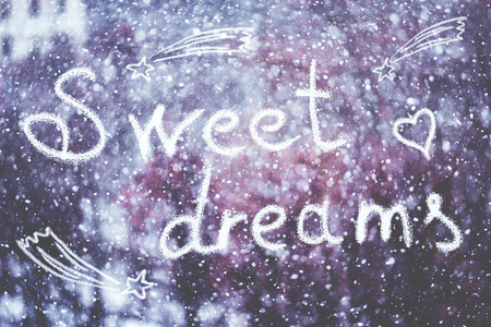 Sweet dreams, written by hand on the snowstorm winter