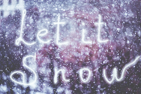 Let it Snow, written by hand on the snowstorm winter