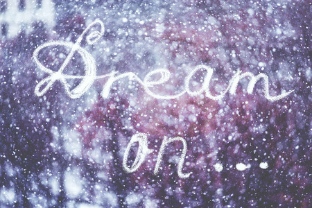Dream on, written by hand on the snowstorm winter