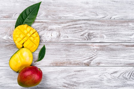Mango. Tropical Fruits. On a wooden background. Top view. Copy space 版權商用圖片