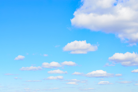 White cumulus clouds in blue sky at daytime. Natural background photo texture.