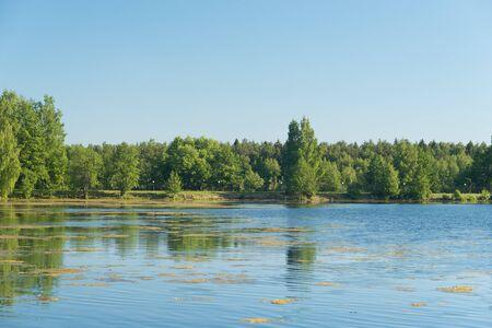 Blue lake in forest, Russian landscapes, beautiful nature. Archivio Fotografico - 127351421