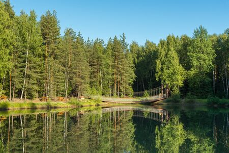 Blue lake in forest, Russian landscapes, beautiful nature. Beautiful bridge Archivio Fotografico - 126882663
