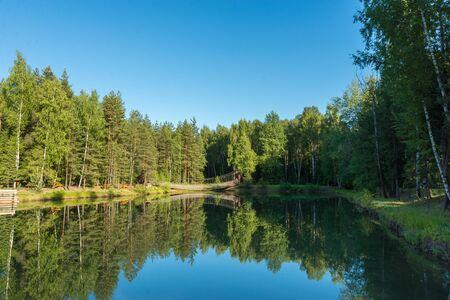 Blue lake in forest, Russian landscapes, beautiful nature. Archivio Fotografico - 126882733
