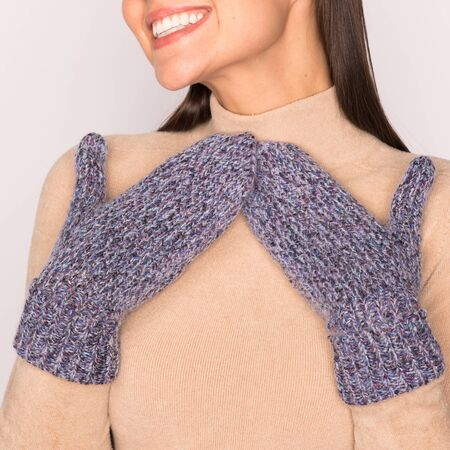 Happy young woman in mittens smiling. Close up Archivio Fotografico - 131820332