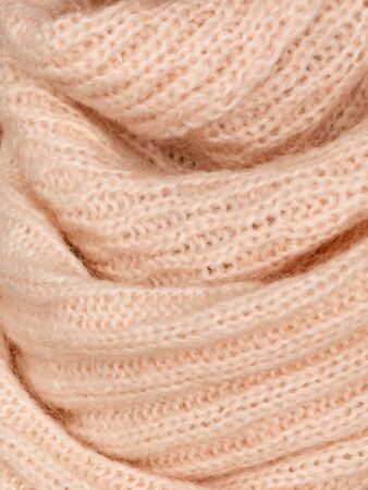Knitted fabric natural beige wool cozy texture.