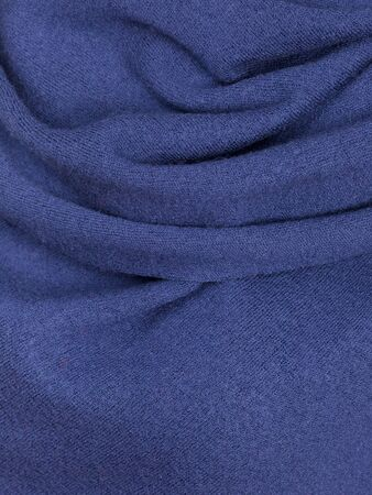 Knitted fabric blue wool cozy texture..