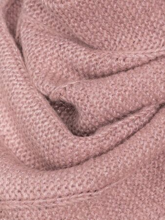 Knitted pink fabric wool cozy texture.