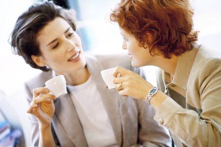 Two businesswomen having coffee