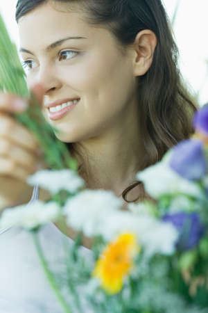 distractions: Young woman making fresh flower arrangement
