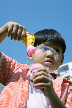 distractions: Boy making bubbles with bubble gun