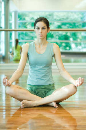 full length mirror: Woman sitting in lotus position