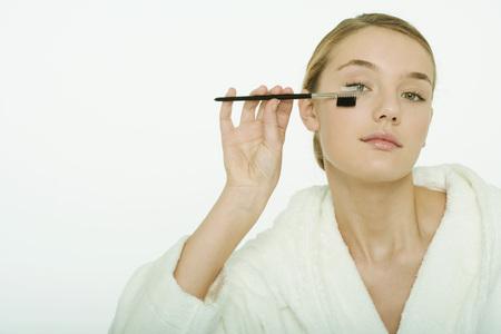 Teenage girl brushing eyelashes