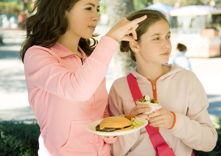 distractions: Two girls eating fast food