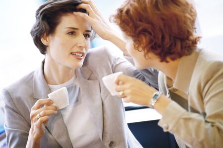 front facing: Two businesswomen having coffee