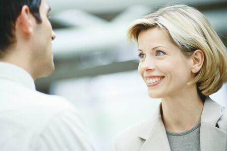 Business associates talking, close-up