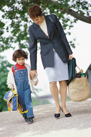 Businesswoman walking with son LANG_EVOIMAGES