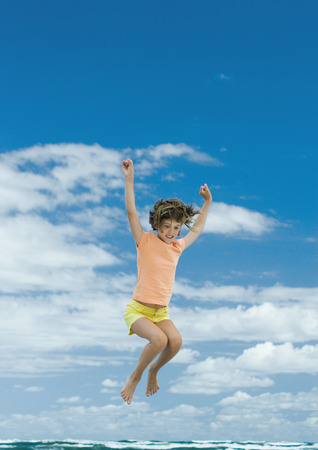 short shorts: Girl jumping, sky in background