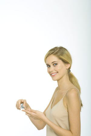 Teenage girl applying foundation
