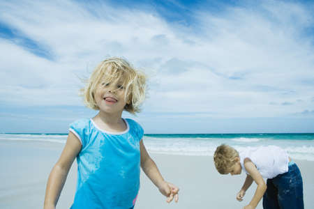 messed: Children playing on beach LANG_EVOIMAGES