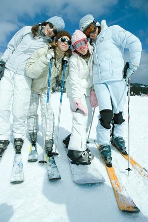 Group of teen girls in ski gear, full length portrait LANG_EVOIMAGES
