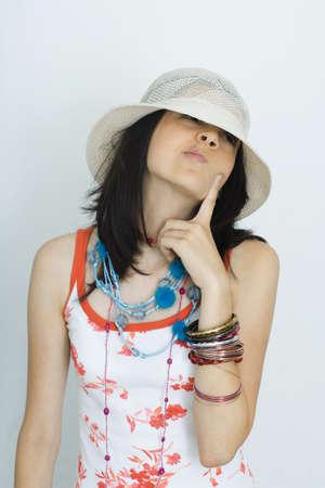 Teenage girl wearing hat, looking away, portrait