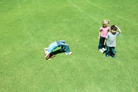 Children playing ball on grass
