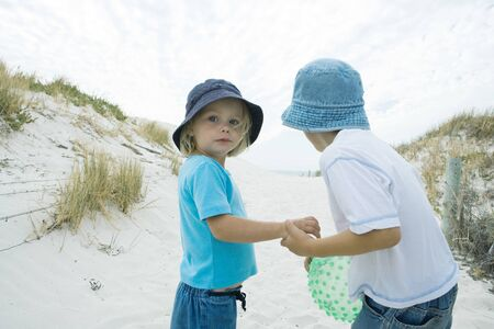 Children standing in dunes LANG_EVOIMAGES