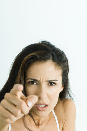 accusations: Woman pointing at camera angrily, portrait
