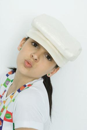smooching: Teenage girl looking at camera, puckering lips, portrait LANG_EVOIMAGES