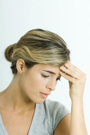 unease: Woman, holding head, portrait