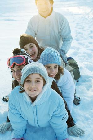 Group having fun in snow, portrait