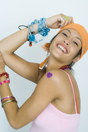 heartshaped: Teen girl wearing lots of accessories, smiling at camera, portrait