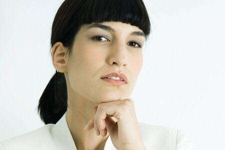 authoritative woman: Woman, hand under chin, portrait