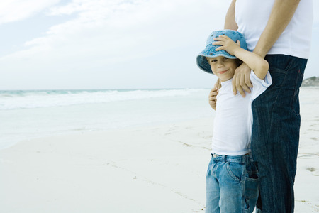sunhat: Child and parent on beach